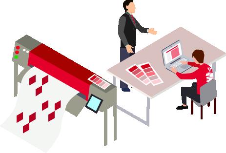 印刷機とパソコンが置いてある机
